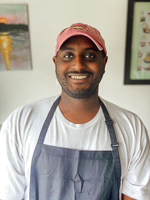 chef Paulos Belay in an apron smiling
