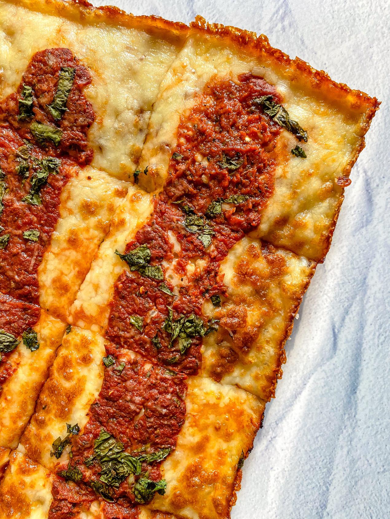 close up pizza with marinara sauce and cheese