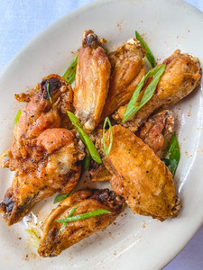 Honey Old Bay Wings on a white plate