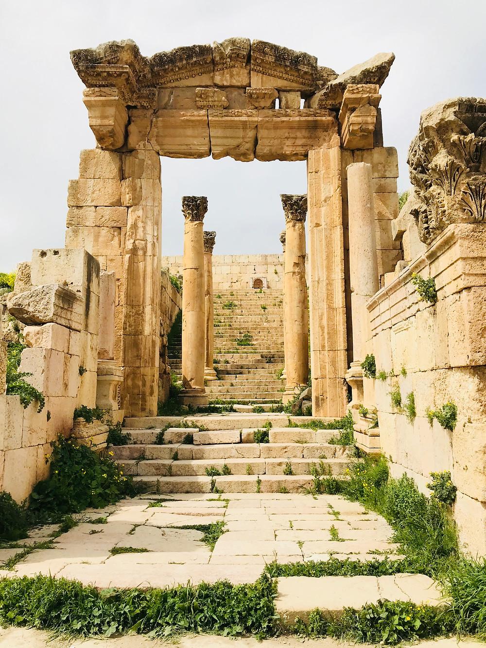 A crumbling carved entranceway at Jerash in Jordan