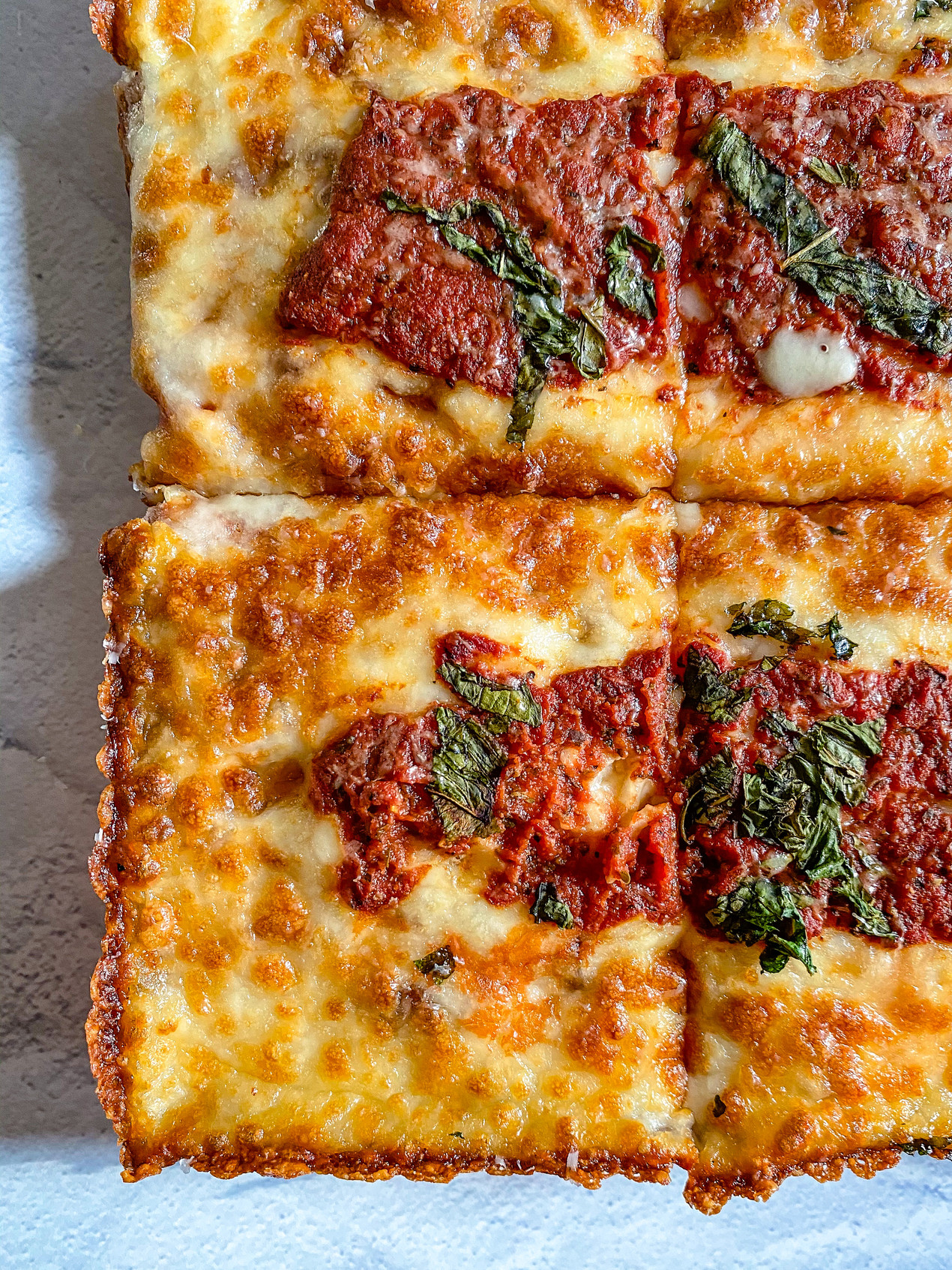 Close up of corner slices of classic Detroit-style pizza from new Black-owned restaurant in DC, Motown Square