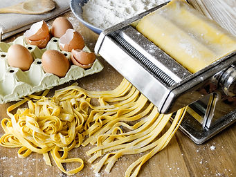 Fresh pasta cutting in machine. Fettucci