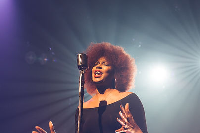 woman-singing-on-stage-hand-movement.jpg