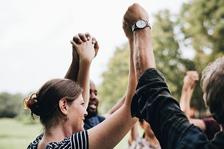 happy-diverse-people-holding-hands-park_SML.jpg