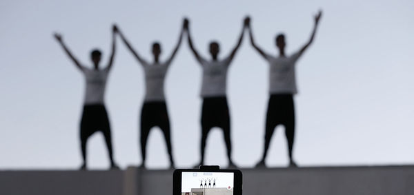 Film still from Yalla Parkour, a documentary film by Areeb Zuaiter. Gaza Parkour athlets on rooftop.