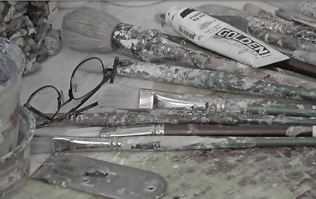 Film still from Colors of Resistance, Documentary film by Areeb Zuaiter.: Samia Halaby's painting supplies.