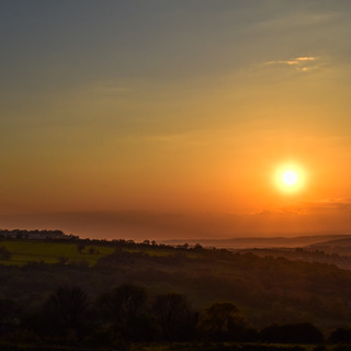 The sun setting over Somerset