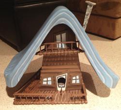 a bird home (a cottage replica)