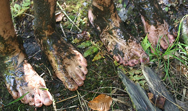 Muddy bog walkers' feet afterg guided hike
