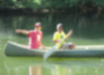 Guide and paddler in canoe