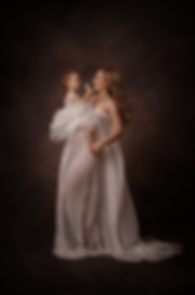 A mother during her maternity portrait session with her child