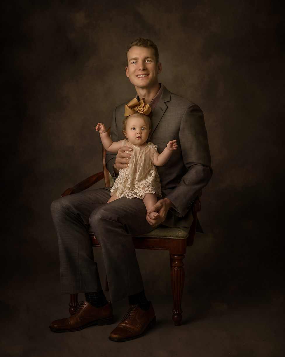 A professional photograph of a father and his daughter
