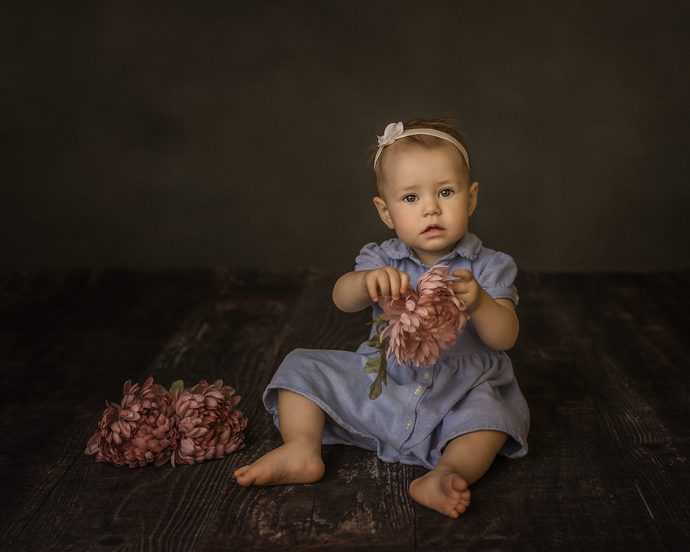 A professional image of a young girl in a photography studio