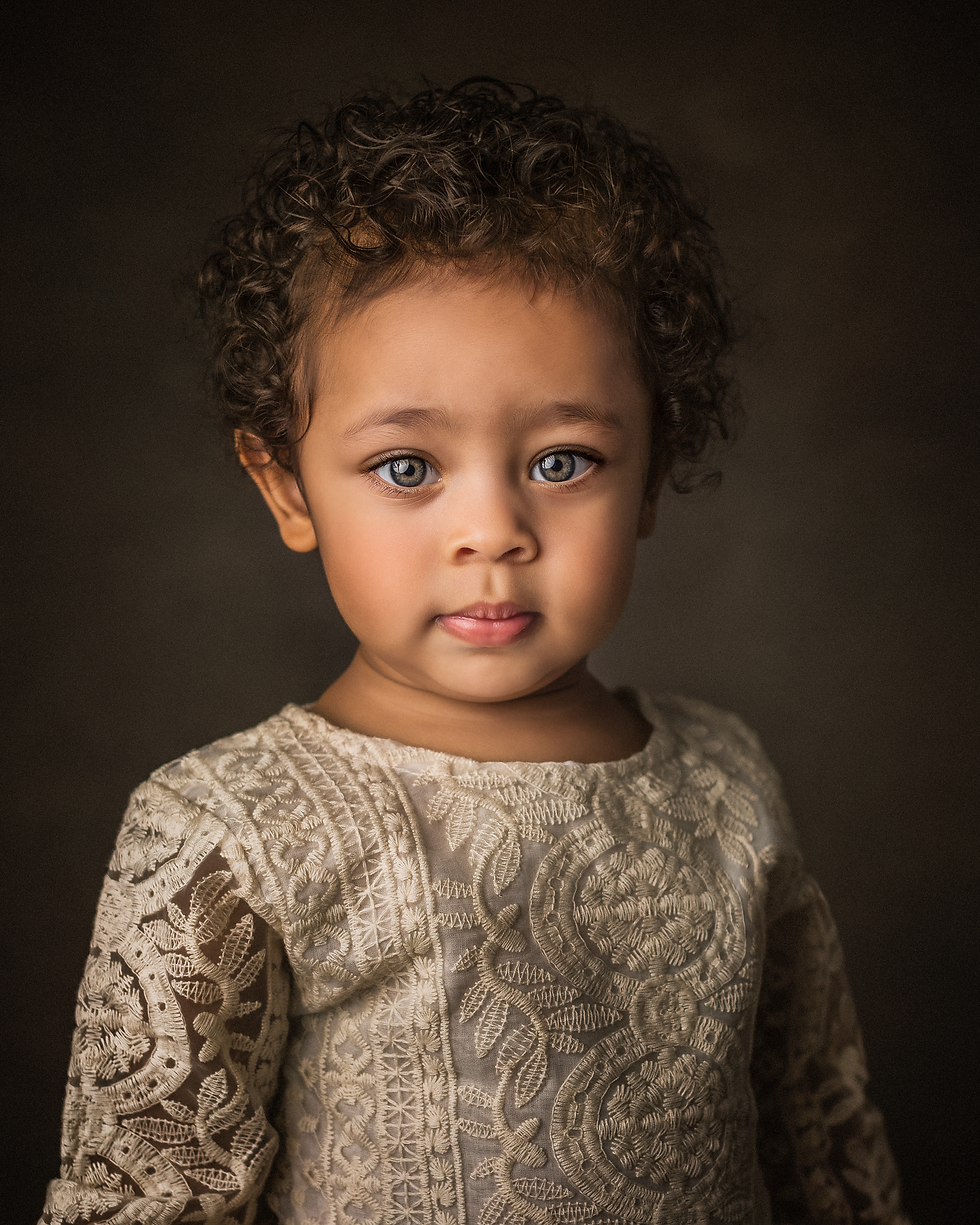 A professional photograph of a 2 year old girl