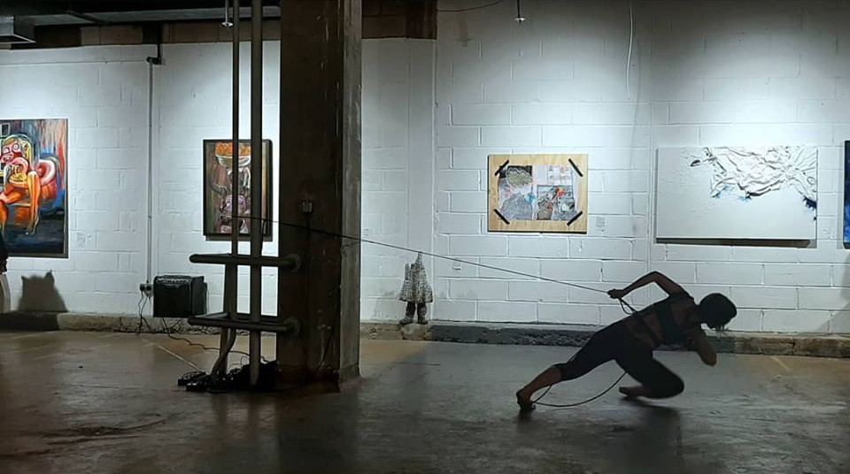 """Performing at the Old Biscuit Factory, the opening of """"Vicious Circle"""" exhibition by Art Number 23, 6th of December, 2019.    Sound for performance created by the manipulation of rope, using contact mics, reverb/delay/distortion pedals and basic amplification."""