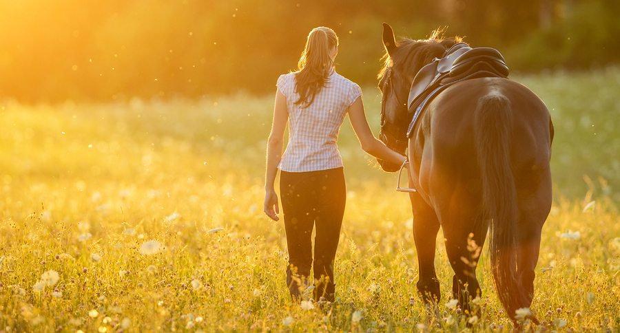bigstock-Backview-of-young-woman-walkin-