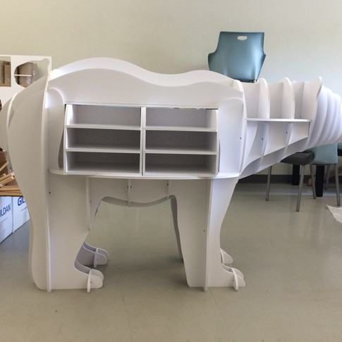 Custom design and assembly in house for a Polar bear shelving unit
