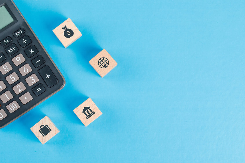 financial-concept-with-icons-wooden-cubes-calculator-blue-table-flat-lay.jpg