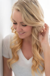 Blonde halo extensions with soft wavy curls