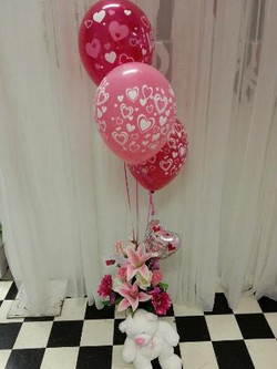 Flowers & Latex Balloons $75
