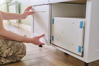 closeup-process-assembling-kitchen-furniture-hands-male-worker.jpg