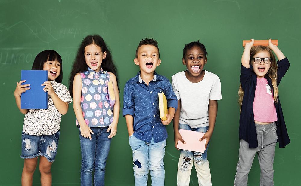 Kids in front of chalkboard