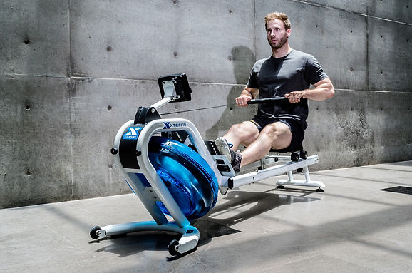 A man exercising on xterra water rower