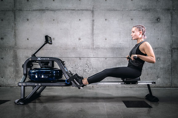 A girl training on xterra water rower