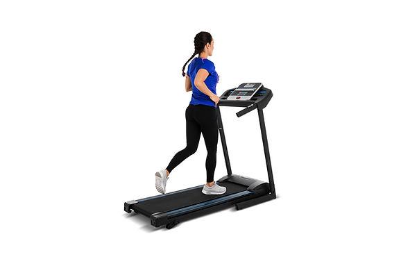 Girl running on xterra tr150 treadmill