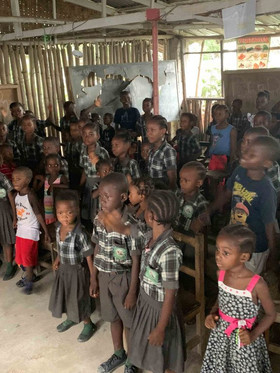 Doing song program for the orphans