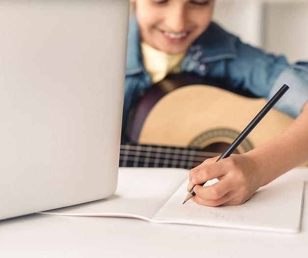 Boy taking online music lessons
