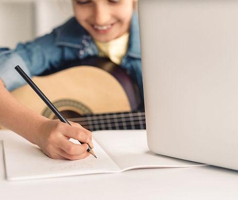 boy taking online guitar classes