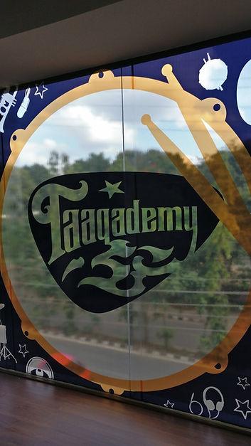 taaqademy music academy logo on glass