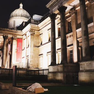 Homeless person at Trafalgar Square, London