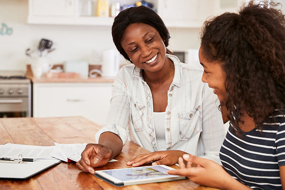 Mother Helps Teenage Daughter With Homew