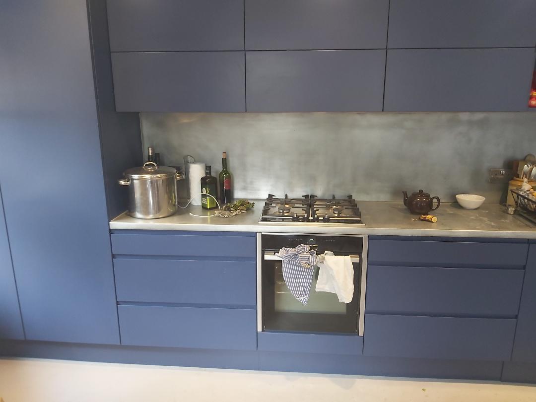 Navy kitchen with splashbacks