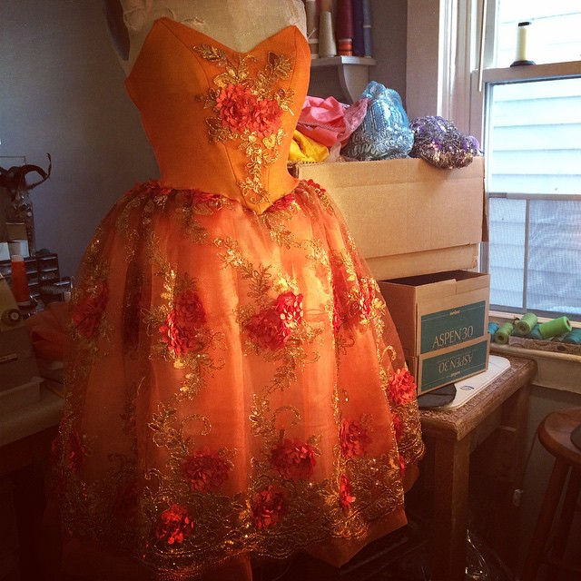Orange fairy costume in the works for Sleeping Beauty-rest of fairy fabrics in the box waiting to be
