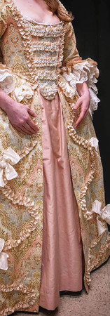 The pinked trim is all cut on the bias and raw-edged. It is hand backstitched on, and the bows are made of wired ribbon.