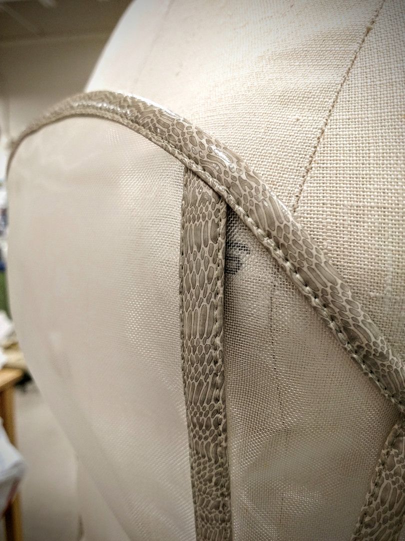Detail: Binding the edges are bound (until the back fabric panels) with a double-fold of the snakeskin pleather.