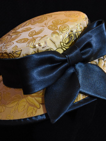 Detail: petal-shaped bow tails