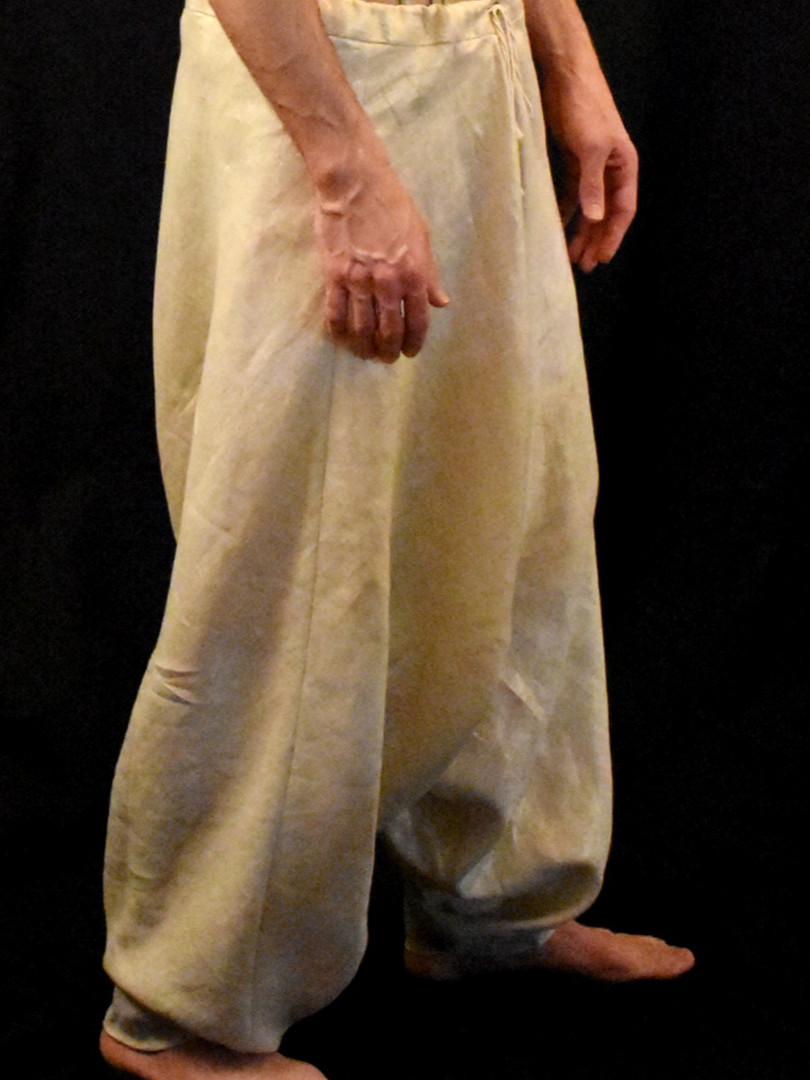 The hem of eah leg is not ciruclar-- the inner leg finishes at a point. This allows the 'cuff' to remain relatively fitted yet still open enough to slide over the foot.