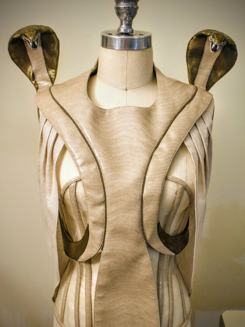Collar with shoulder snakes and pleated arm drape