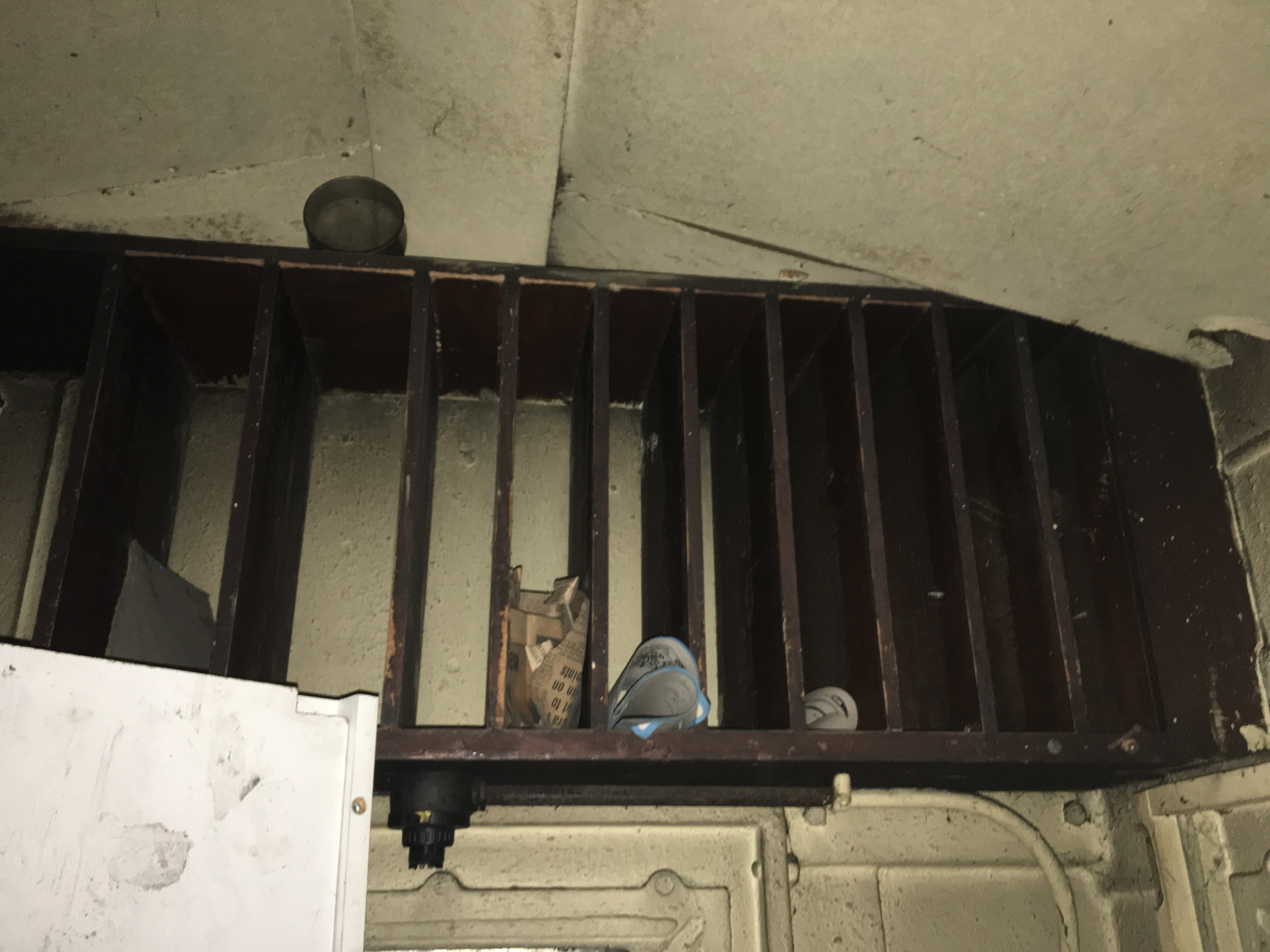 Shelf at ceiling, above desk