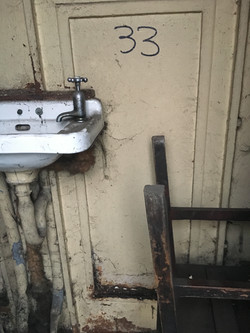 Basin and upended stool