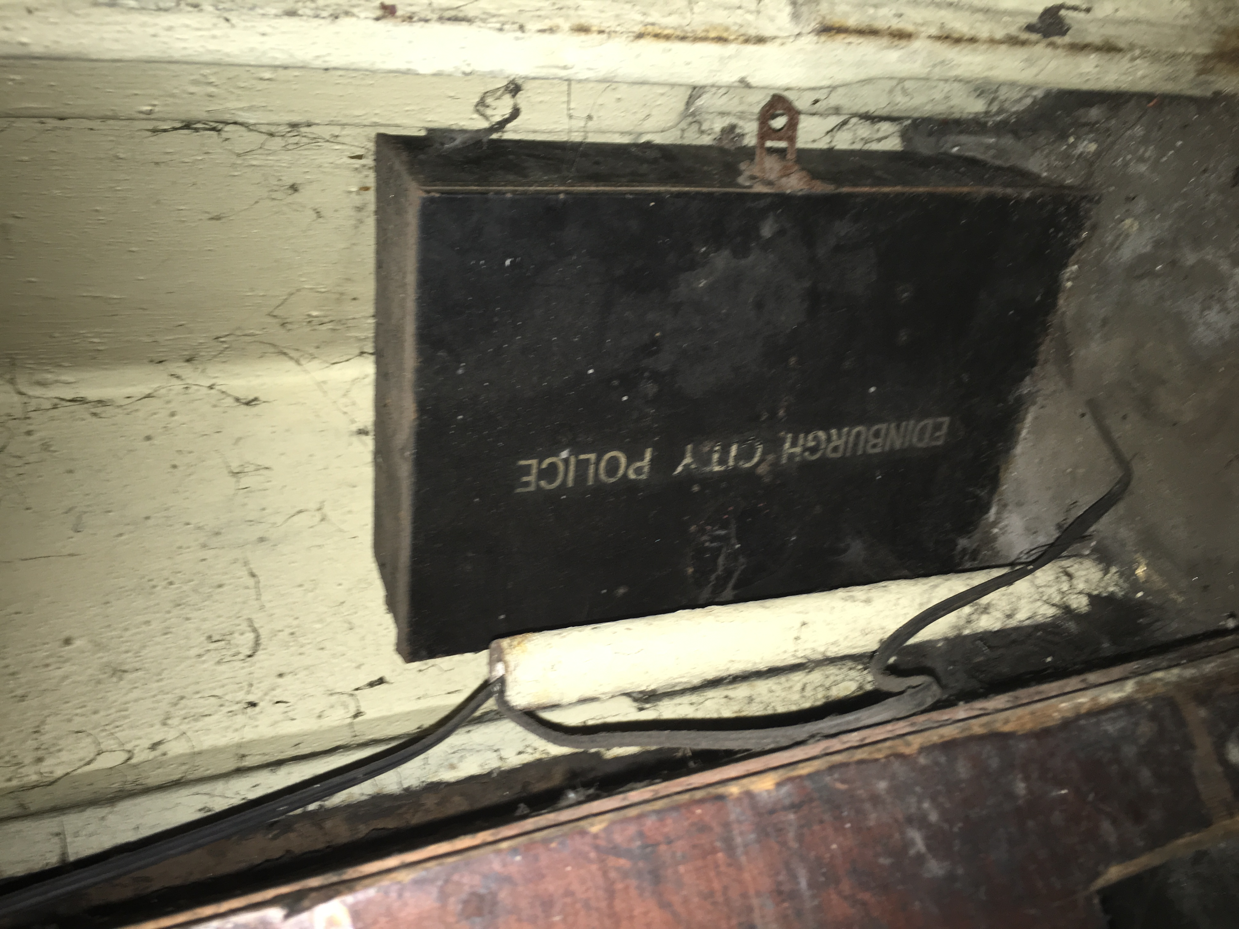 Black tin box under desk