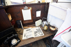 Desk with telephone and kettle