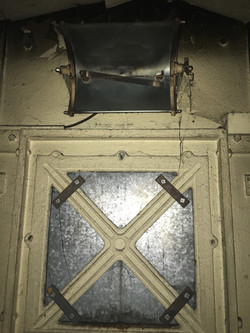 Electric fire over right-hand window