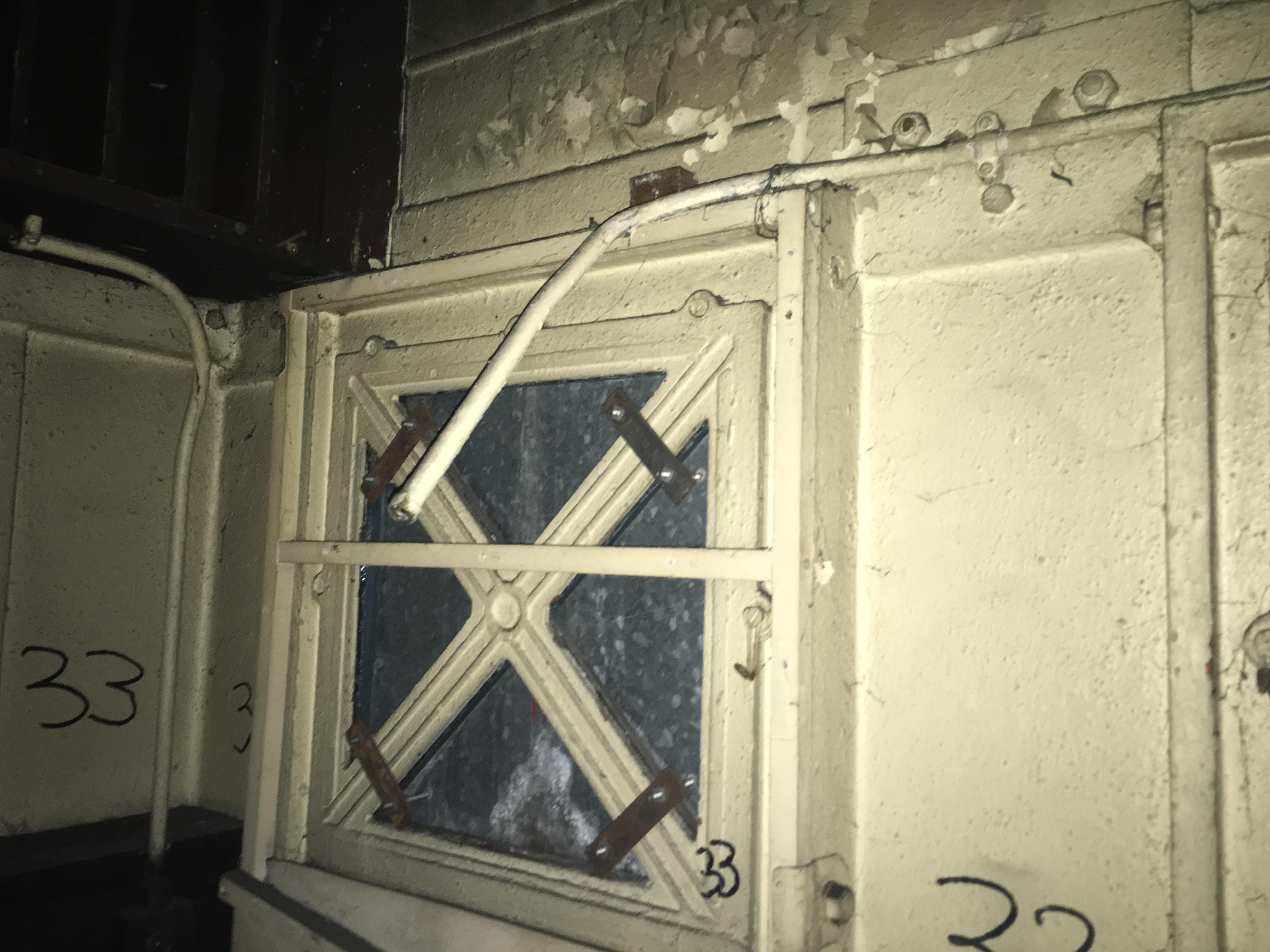 Another window covered by a plate