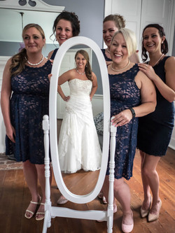 Bridal Party admiring bride in mirro