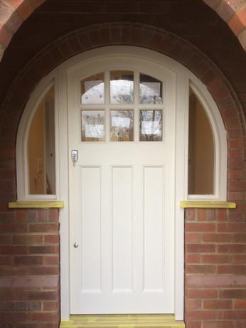 Door with joined window frames